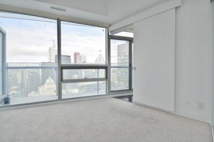 Master Bedroom With Sliding Doors, Mirrored Closet & Custom Roller Shades.