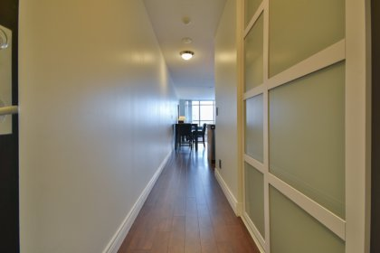 Suite Foyer With Laminate Flooring Throughout & Upgraded Closet Doors.