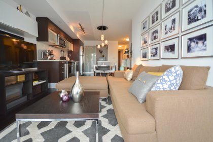 Bright Open Concept Living & Dining Areas With Floor-To-Ceiling Windows & Hardwood Flooring Throughout.