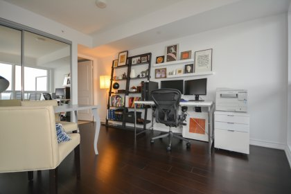 A Spacious Sized Master Bedroom With A 4-Piece Ensuite, Mirrored Closet & Hardwood Flooring.