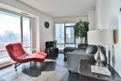 Bright Floor-To-Ceiling Windows With Hardwood Flooring Throughout & A Huge Private Wrap Around Balcony Facing C.N. Tower Views.