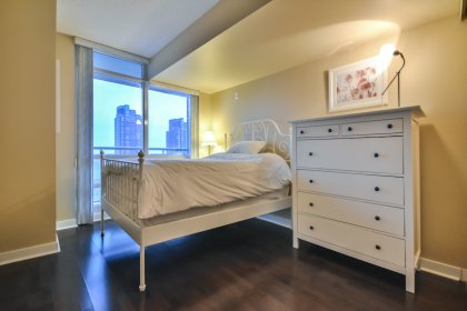 2nd Bedroom With Hardwood Flooring & A Large Window Facing Lake Views.