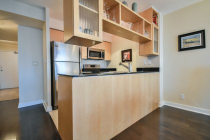 Designer Kitchen Cabinetry With Upgraded Stainless Steel Appliances & Granite Counter Tops.