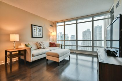 Bright Floor-To-Ceiling Windows With Hardwood Flooring Throughout Facing Unobstructed South Lake Views.