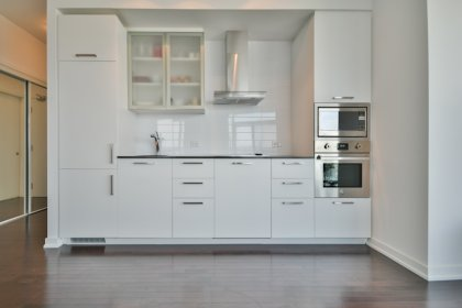 Designer Kitchen Cabinetry With Stainless Steel Appliances, Granite Counter Tops & An Undermount Sink.