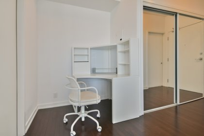 Open Concept Study Area With Hardwood Flooring.