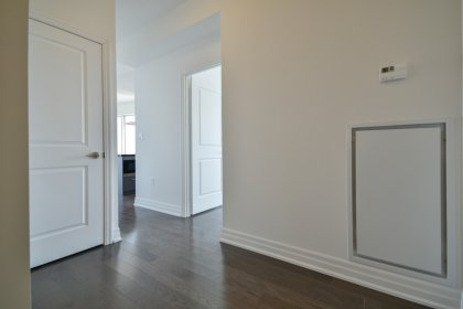 Suite Foyer With Gleaming Hardwood Flooring.