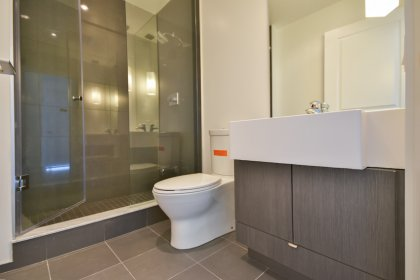Main Bath With A 3-Piece Including A Frameless Glass Stand-Up Shower.