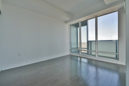 A Spacious Sized Master Bedroom With A 4-Piece Ensuite, Privacy Glass Sliding Doors & Gleaming Hardwood Flooring.