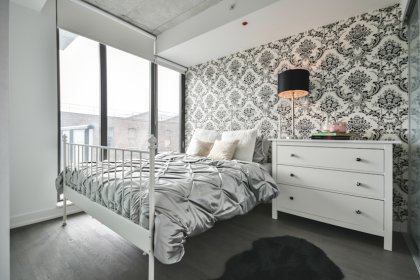 A Spacious Sized Master Bedroom With A Glass Sliding Privacy Door & Large Closet.