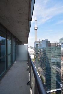 A Large Private Balcony With C.N. Tower Views.