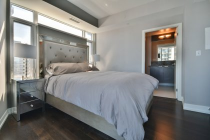 A Spacious Sized Master Bedroom With A 4-Piece Ensuite, Hardwood Flooring & A Large Closet.