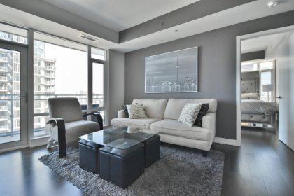 Bright Floor-To-Ceiling Windows With Hardwood Flooring Throughout & A Huge Private Balcony Facing North City Views.