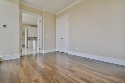 Dining Room Or Private Home Office With Crown Molding & Hardwood Flooring Facing Stunning Unobstructed Picturesque City and Financial District Views.