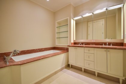 Grand Master Ensuite Including Double Sinks With Marble Counter Tops, Separate Soaker Tub, Glass Stand-Up Shower, Heated Towel Rack & Heated Flooring.