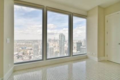 An Eat-In Kitchen Area Facing Stunning Unobstructed Picturesque City and Financial District Views.