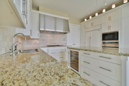 Luxurious Designer Bellini Custom Kitchen Cabinetry With Sub-Zero, Miele & Wolf Stainless Steel Appliances With Undercounter Wine Storage.