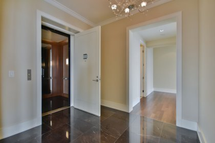 The Grand Foyer With A Private Elevator, Marble Flooring and Crown Molding.
