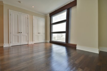 Grand 2nd Bedroom With High Double Entry 8-Foot Doors, A 4-Piece Ensuite, Double Closets, Crown Molding & Hardwood Flooring Facing East City Views.