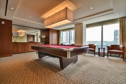 The Exclusive Residents-Only 21st Floor Games Room Lounge With Billiard and Large Flat Screen T.V.