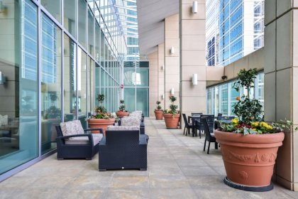 The Outdoor Terrace Including A Lounge Eat Area and  Barbecues Facing Spectacular C.N. Tower & Lake Views.