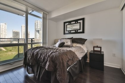 A Spacious Sized Master Bedroom With Laminate Flooring, A Large Wall-To-Wall Closet & A Large Window Facing Unobstructed Park Views.