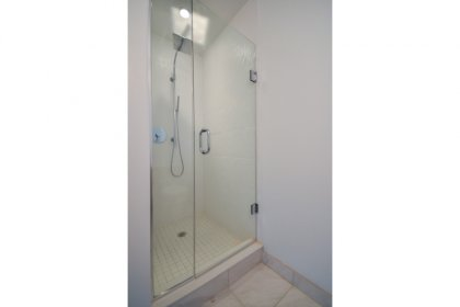 Master Ensuite With A 3-Piece & Frameless Glass Stand-Up Shower.