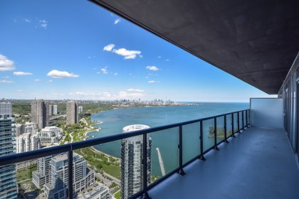 Huge Wrap Around Balcony Facing Stunning C.N. Tower & Lake Views.