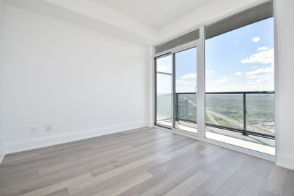 A Spacious Sized Master Bedroom With A 3-Piece Ensuite, Laminate Flooring, Mirrored Closet & A Walk-Out Balcony.