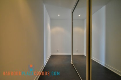 Suite Foyer With Laminate Flooring and Mirrored Closet.