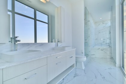 Master Bedroom Ensuite With A 5-Piece Including A Separate Glass Stand-Up Shower & A Large Soaker Tub.