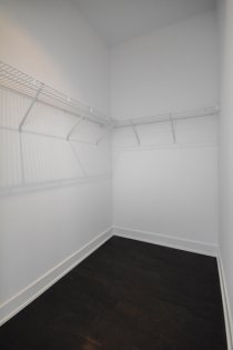 Master Bedroom Walk-In Closet With A Pocket Door.