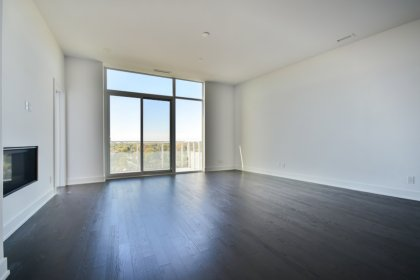 Bright Floor-To-Ceiling Windows With Hardwood Flooring Throughout, A Gas Fireplace & A Huge Private Entertaining Terrace.