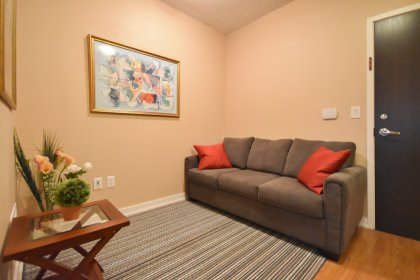 Large Open Concept Den Area With Laminate Flooring.