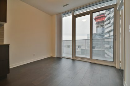 Bright Floor-To-Ceiling Windows With Laminate Flooring Throughout With Stunning Balcony Lake & Island Airport Views.