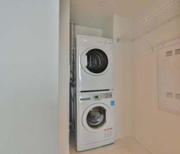 Ensuite Washer/Dryer With Storage Area.