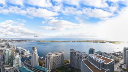 Panoramic View Facing Stunning Unobstructed Lake & Island Airport Views.