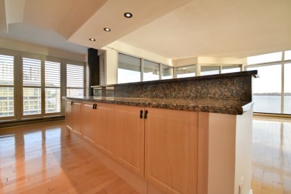 Designer Kitchen Cabinetry With Gleaming Hardwood Flooring, Granite Counter Tops, A Breakfast Bar & Eat-In Area.