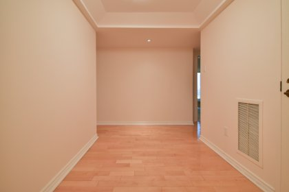 Suite Foyer With Gleaming Hardwood Flooring & A Closet.