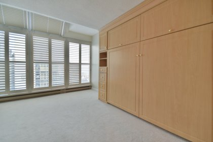 2nd Bedroom With A Built-In Murphy Bed And California Shutters.