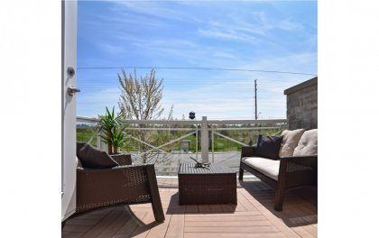 The Private Sun Filled Terrace Facing Unobstructed Parkland Views.