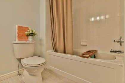 Remodeled Top Floor Main Bathroom With A 5-Piece & Convenient Double Sinks With Laundry Area.