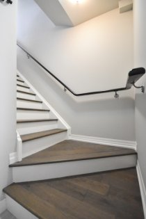 Ground Floor Garage Access Staircase With  Upgraded Hardwood Flooring Leading Up To The Living & Dining Areas.