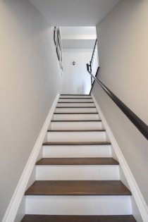 Ground Floor Staircase With Lakeshore Road Access To The Street & Lake Including Upgraded Hardwood Flooring Leading Up To The Living & Dining Areas.