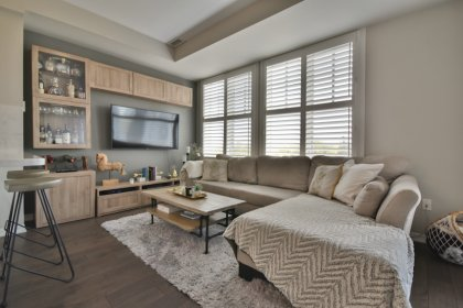 Open Concept Living & Dining Areas With Hardwood Flooring & California Window Shutters Throughout.