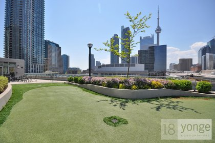 An Outdoor Rooftop Tanning Deck With Mini-Golf Putting Green & Barbecues.