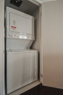 Laundry Area With A Stacked Washer/Dryer.