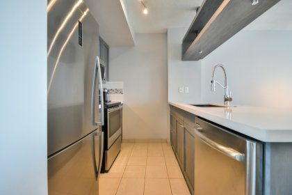New Remodelled Designer Kitchen Cabinetry With Stainless Steel Appliances, Granite Counter Tops, An Undermount Sink & A Breakfast Bar.