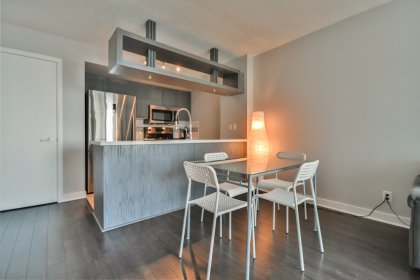 Open Concept Dining Area With Laminate Flooring.