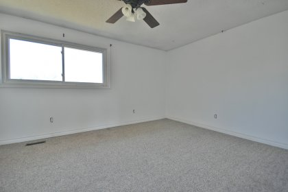 Spacious Sized Master Bedroom With A Wall To Wall Closet & A Large Window.
